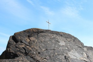 cross on top of rock